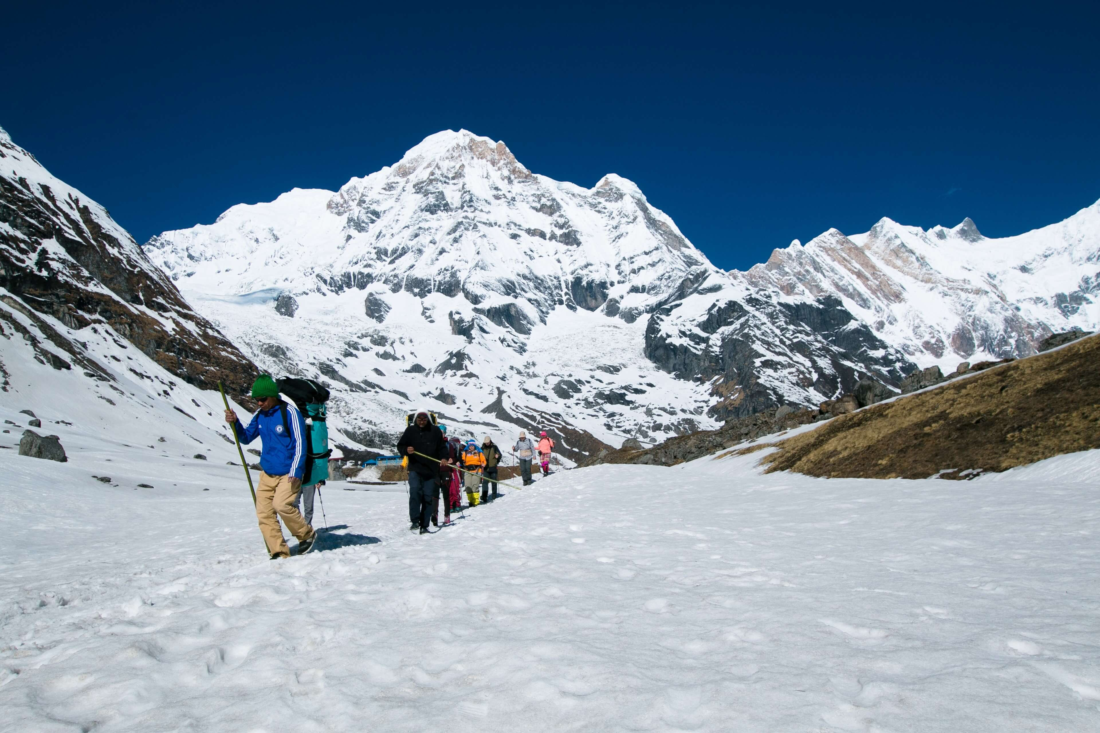 Guides, Porters & Trekkers Descending From Base Camp